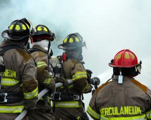 bigstockphoto_firemen_fighting_1360970